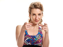 Sportswoman pointing on camera Royalty Free Stock Image