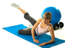 Sportswoman practicing yoga Royalty Free Stock Images