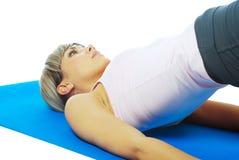 Sportswoman practicing yoga Stock Photos