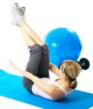 Sportswoman practicing yoga Stock Photography
