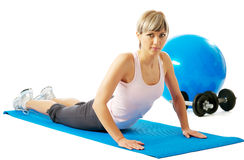Sportswoman practicing yoga Stock Images