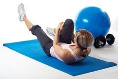 Sportswoman practicing yoga Stock Image