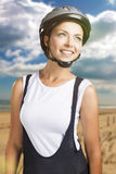 Sportswoman in professional cycling clothes posing against natur Royalty Free Stock Photography