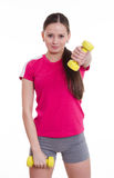 Sportswoman raised her left arm with a dumbbell Royalty Free Stock Image