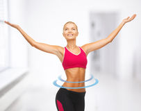 Sportswoman with raised up hands Stock Photos