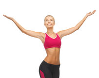 Sportswoman with raised up hands Royalty Free Stock Images