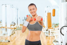Sportswoman with red weights Royalty Free Stock Image