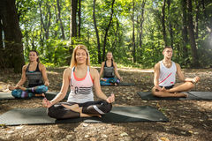 Sportswoman relaxing in nature with body balance exercise Stock Image