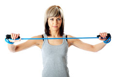 Sportswoman with resistance band Stock Photos