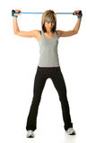 Sportswoman with resistance band Stock Images