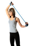 Sportswoman with resistance band Stock Photo