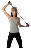 Sportswoman with resistance band. Sportswoman exercising with a resistance band. Solid white background Royalty Free Stock Photo
