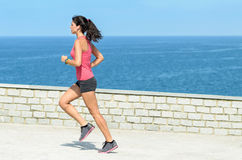 Sportswoman running on summer Royalty Free Stock Photography