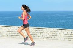 Sportswoman running on summer Royalty Free Stock Photography