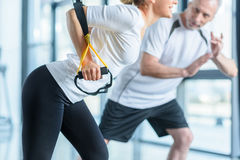Sportswoman and senior trainer training with resistance band Royalty Free Stock Photo
