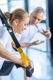 Sportswoman and senior trainer training with resistance band Stock Photography