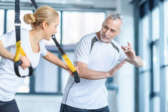 Sportswoman and senior trainer training with resistance band Royalty Free Stock Images