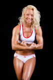 Sportswoman showing her muscles Stock Photography