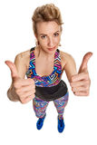 Sportswoman showing thumbs-up Royalty Free Stock Photos