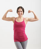 Sportswoman showing two biceps Stock Photo
