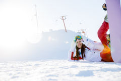 Sportswoman with snowboard in snow. At mountains Stock Photography