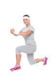 Sportswoman som gör övningar Royaltyfria Foton