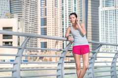 Sportswoman speaks on cell phone during a break in training. Ath Royalty Free Stock Image