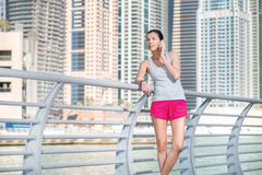 Sportswoman speaks on cell phone during a break in training. Ath Royalty Free Stock Images