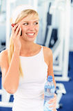 Sportswoman speaks on phone Royalty Free Stock Photography