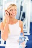 Sportswoman speaks on phone Royalty Free Stock Photography