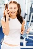 Sportswoman speaks on phone Stock Photography