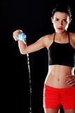 Sportswoman spilling a water Royalty Free Stock Images