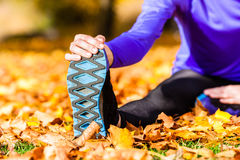 Sportswoman sport stretching in autumn Stock Photos