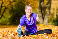 Sportswoman sport stretching in autumn Royalty Free Stock Photos