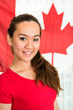 Sportswoman Standing Against Canadian Flag Stock Image