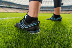 Sportswoman standing on soccer stadium grass Royalty Free Stock Photography
