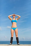 Sportswoman stands outdoors with hands on forehead like visor Stock Photos