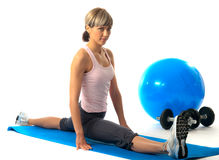 Sportswoman stretching Stock Image