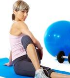Sportswoman stretching Royalty Free Stock Image