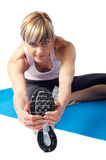 Sportswoman stretching Stock Images