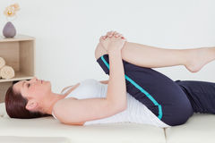Sportswoman stretching her leg royalty free stock photo
