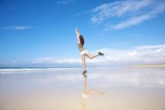 Sportswoman stretching on seashore Royalty Free Stock Image