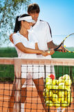 Sportswoman with tennis instructor Stock Images