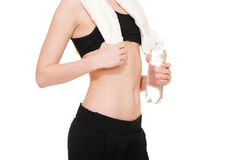 Sportswoman with towel and bottle of water Stock Photo
