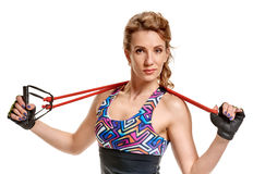 Sportswoman training with expander Stock Photography