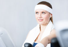 Sportswoman training on gym equipment in gym Royalty Free Stock Photo