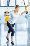 Sportswoman training with resistance band in sports center Royalty Free Stock Photo