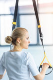 Sportswoman training with resistance band in sports center Royalty Free Stock Image