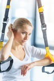 Sportswoman training with resistance band in sports center Royalty Free Stock Photos