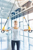 Sportswoman training with resistance band in sports center Stock Photo